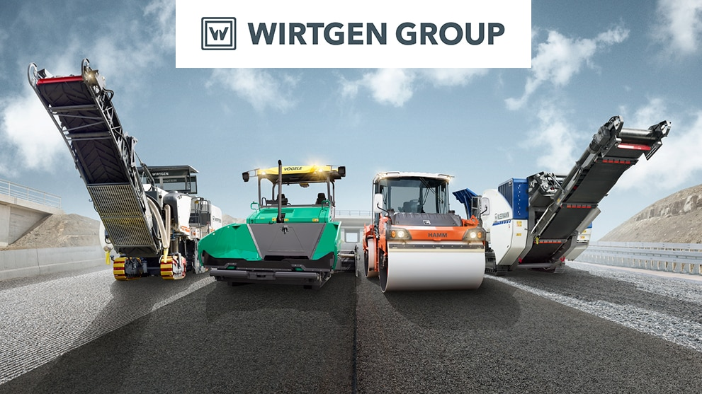 Line up of a Wirtgen cold milling machine, Vögele road paver, Hamm tandem roller and Kleeman crusher on a single road at various stages of development